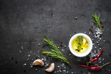 Olive oil rosemary salt pepper garlic. Food background. Cooking ingredients. - 141135248
