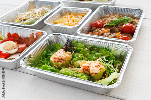 Healthy food take away in foil boxes, meat and vegetables