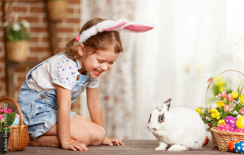 happy easter! happy funny child girl playing with bunny