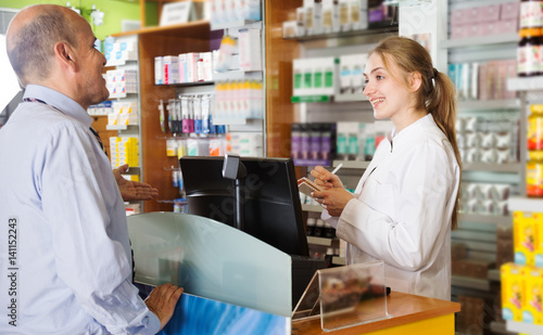 Tuinposter Apotheek Person near counter in pharmacy