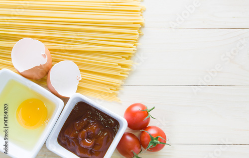 Poster spaghetti with ingredients for cooking