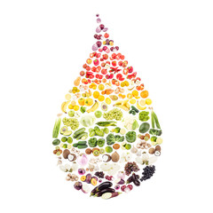 Rainbow made from different raw fruits and vegetables in the drop shape