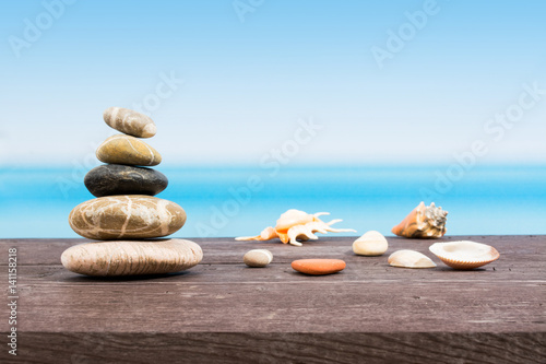 Tropical sea seen from the boat. Stones on table with copy space. Relaxing on board