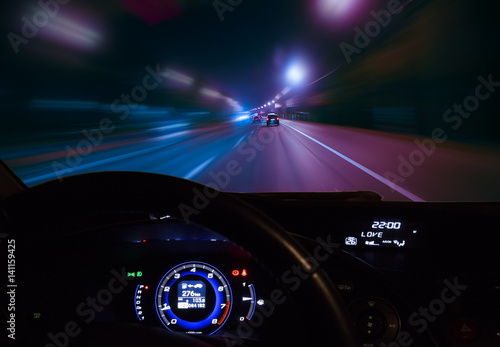 Papiers peints Autoroute nuit car moving on highway at night