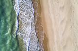 Fototapety Aerial view of the Italian wild beach at sunset