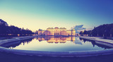 Color toned panoramic view of Belvedere Palace in Vienna after sunset, Austria.