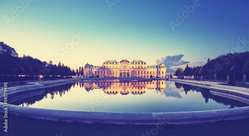 Fotobehang Wenen Color toned panoramic view of Belvedere Palace in Vienna after sunset, Austria.