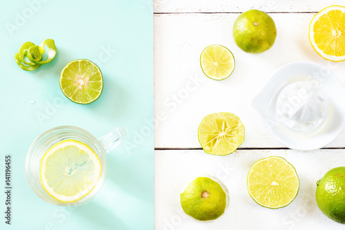 Morning detox water in glass on a white table with empty space. Weight loss concept.