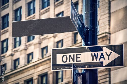 Blank sign and one way roadsign in New York City, USA