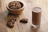 chocolate milk in glass with homemade chocolate cookies with hazelnuts, sweet breakfast