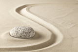zen meditation stone in sand. Concept for purity harmony and spirituality. Spa wellness and yoga background. - 141242457