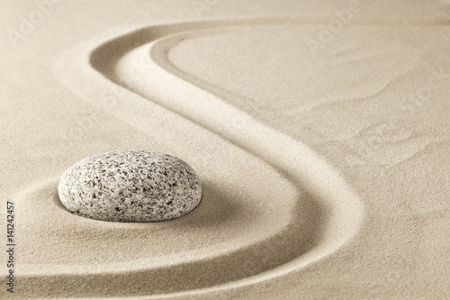 Papiers peints Zen zen meditation stone in sand. Concept for purity harmony and spirituality. Spa wellness and yoga background.