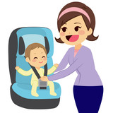 Cute little boy sitting on car baby seat with mother holding him while fasten safety belt