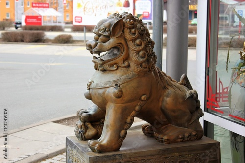 Guardian lions or Fo-dogs flank the entrance gates Buddhist temple Poster
