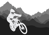 Silhouette of a racer descending on a bicycle on a mountainside