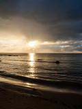 sunset over calm lake beach