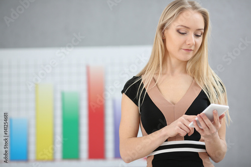 Poster Blond business woman uses mobile offer for trading on Forex