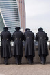Cadets in winter dressed in military uniforms stand and look at skyscrapers