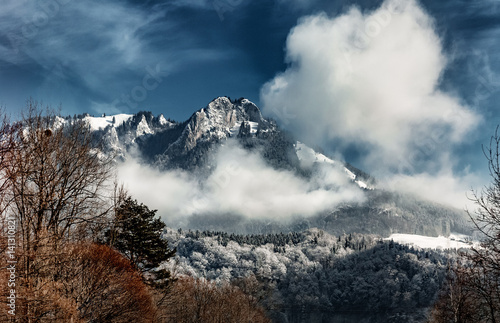Snowy Mountains Peak with clouds