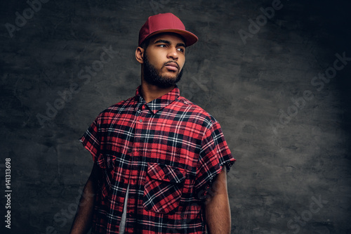 Black bearded male dressed in a red fleece shirt and a cap. Poster