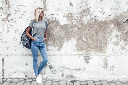 Leinwandbild Motiv Model posing in plain tshirt against street wall