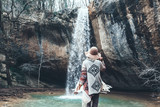 Fototapety Human standing by the waterfall