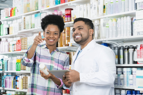 Patient Pointing Away While Standing By Chemist