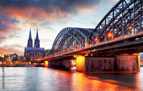 Cologne Cathedral and Hohenzollern Bridge at sunset - night