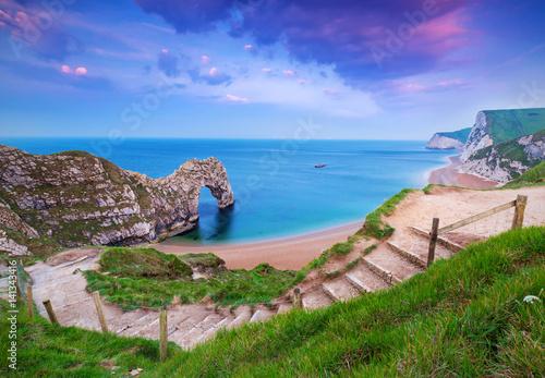 Jurassic Coast of Dorset with Durdle Door at sunrise , UK Poster