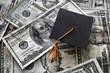 Graduation cap on assorted money