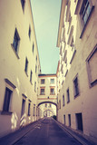 Old narrow street in Vienna, color toned picture, Austria