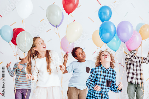 Kids dancing with balloons