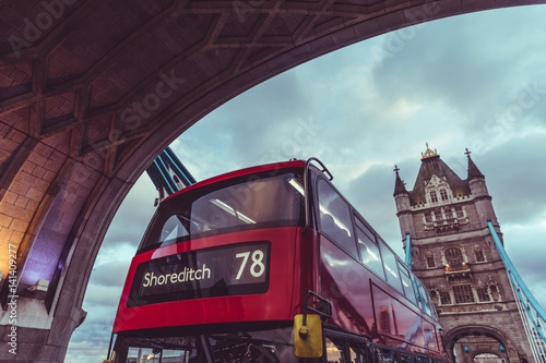London iconic Tower Bridge and double decker red bus Poster