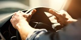 Cropped hands of man holding steering wheel - 141431653