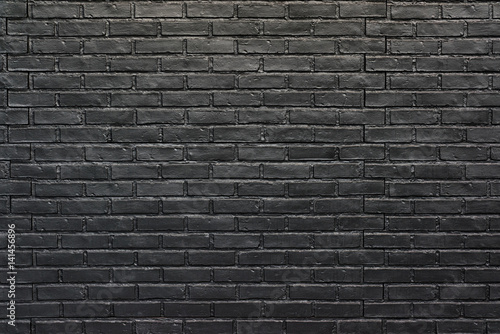 Tuinposter Hout Black brick wall for background, painted brick