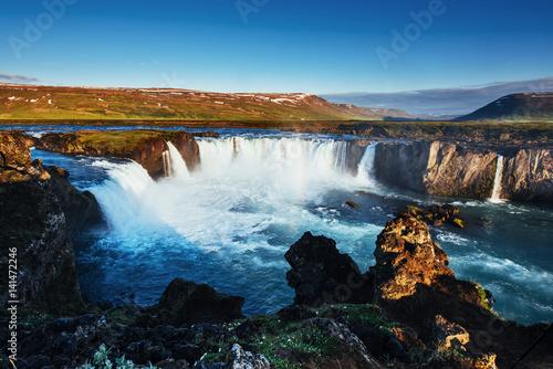 Foto op Canvas Godafoss waterfall at sunset. Fantastic landscape. Beautiful cumulus clouds. Iceland Europe