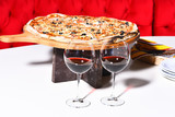 Tasty pizza with two glasses of red wine