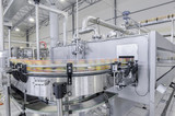conveyor belt in motion at production and bottling of drinks in tin cans. production and bottling of drinks in tin cans - 141484644