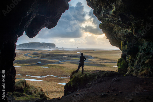 Dryholaus Cave Iceland, small dead end cave in the hill on the Dyrholavegur road Poster