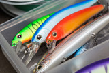 Closeup of a fishing box with colorful lures. - 141522815