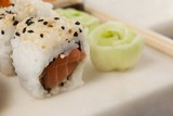 Uramaki sushi served in white plate