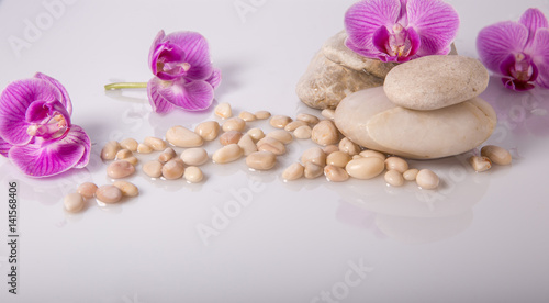 Spa background with stones and purple orchid
