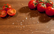 fresh ripe cherry tomatoes on wooden background