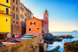 Tellaro sea village street, church and boats. Cinque terre, Ligury Italy
