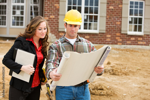 Construction: Architect Reviews Plans with Contractor