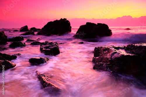 Aluminium Candy roze Sunrise at the beach / Sunrise or sun up is the instant at which the upper edge of the Sun appears over the horizon in the morning