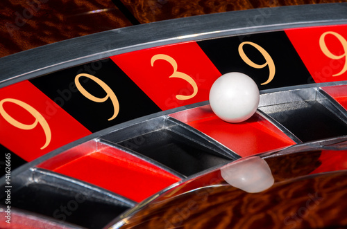 Poster Concept of casino roulette lucky numbers wheel black and red sectors