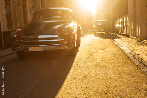 Poster Old car on street of Havana at sunset, Cuba