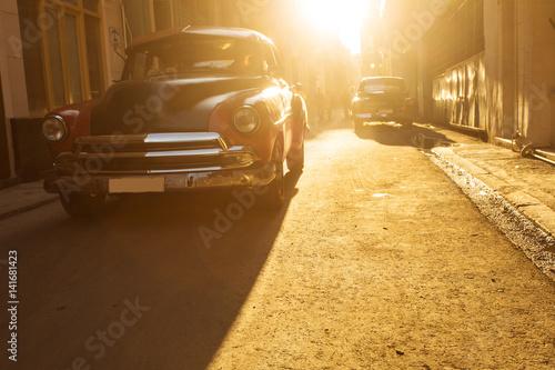 Poster Old car on street of Havana at sunset, Cuba