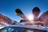 Car roof with two pairs of skis on the rack - 141682261